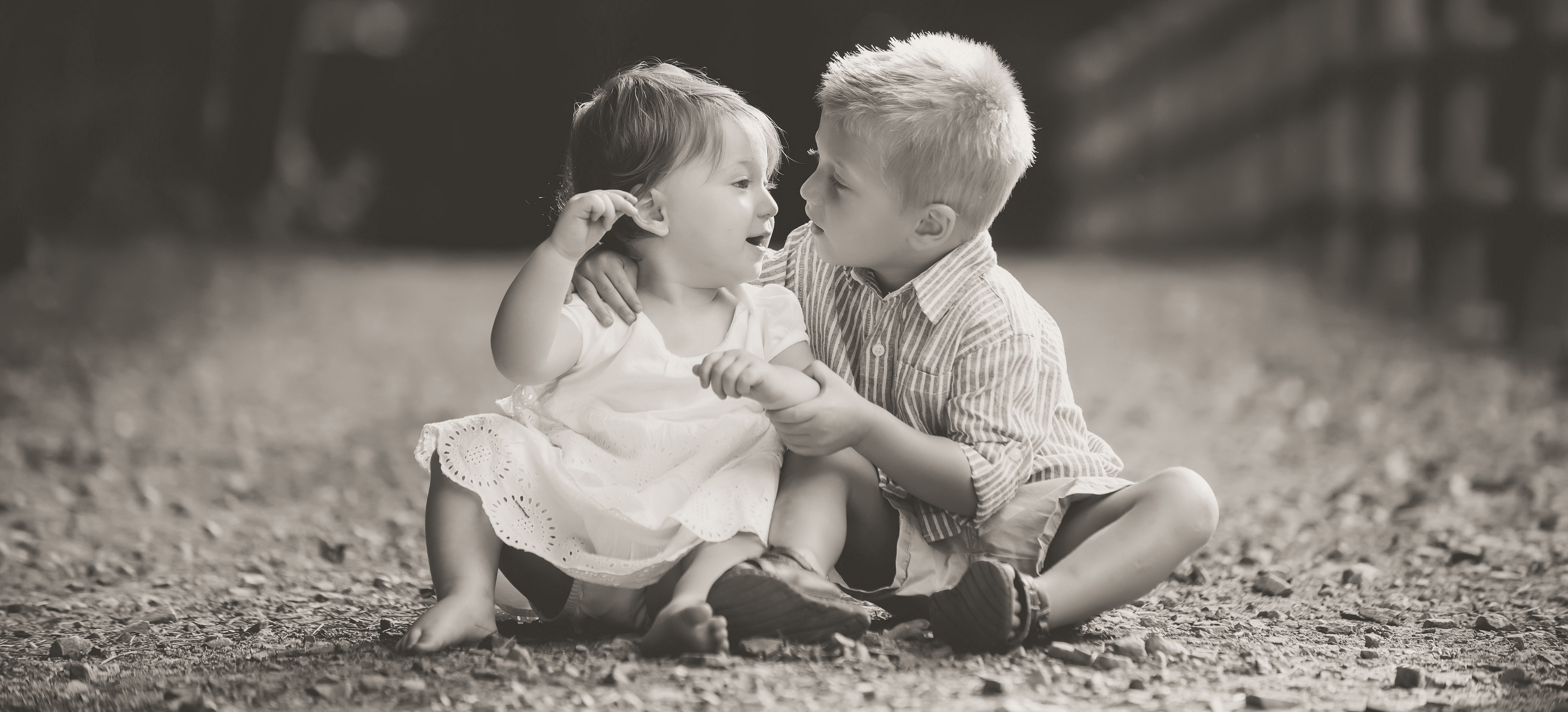 brother and sister hugging at charlotte family session