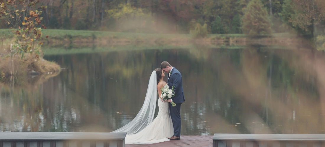 the arbors bride and groom on the dock