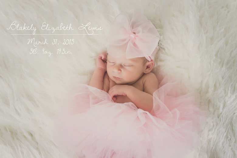 newborn baby girl in pink tutu sleeping on white fur