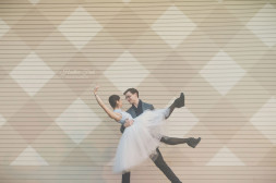 engaged couple performs a dance during their engagement session